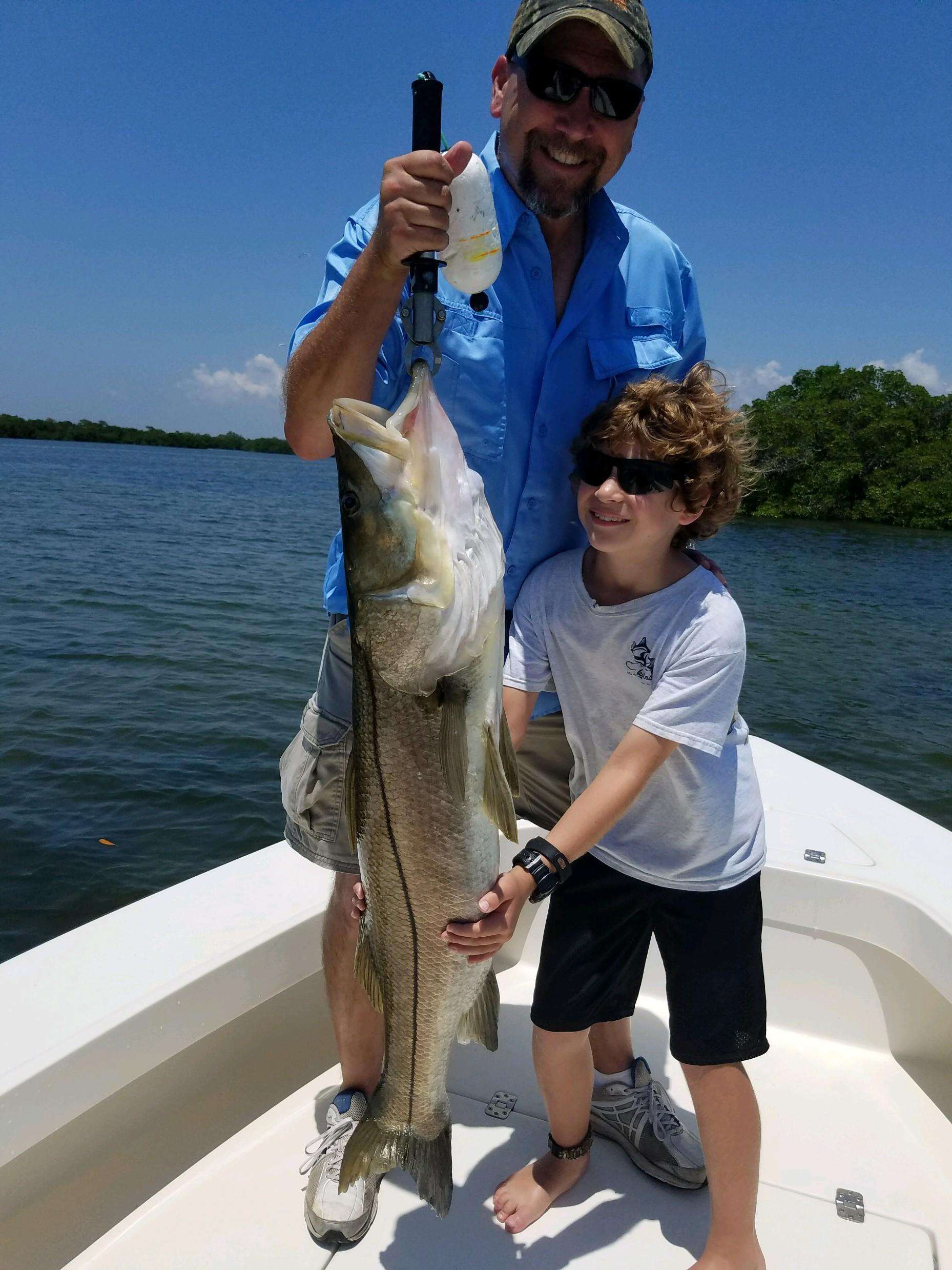 Father and Son with Large Snook